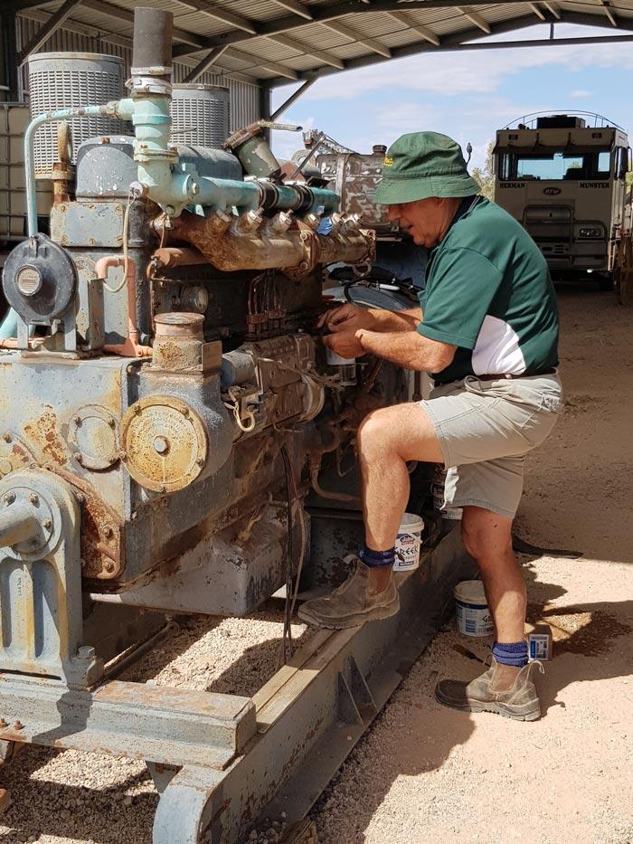 Volunteer John fixing Machinary at Winton Truck & Machinery Museum